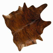 animal skins used for rugs and throw roomsrevamped.com