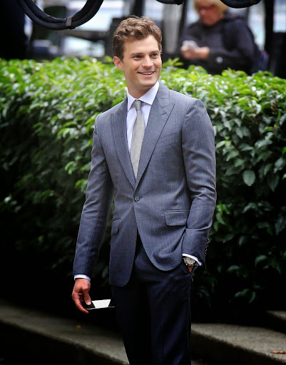 Jamie Dornan in grey suit www.roomsrevamped.com