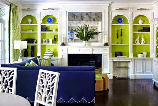 another good example of painting the interiors green on bookcase www.roomsrevamped.com