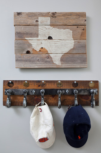 Clever use of  antique hooks for fireman suits.Designed by Robin LaMonte of Rooms Revamped Interior Design