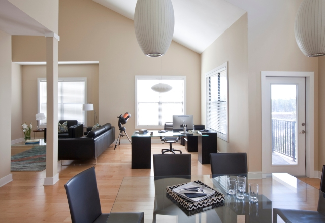 Open floor plan with an office in the condo designed by Robin LaMonte of Rooms Revamped Interior Design