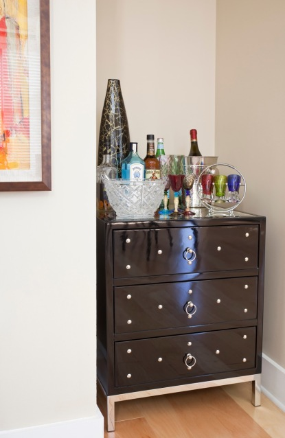 Small bachelor's chest that fit perfectly in this little niche as his mini bar area designed by Robin LaMonte of Rooms Revamped Interior Design