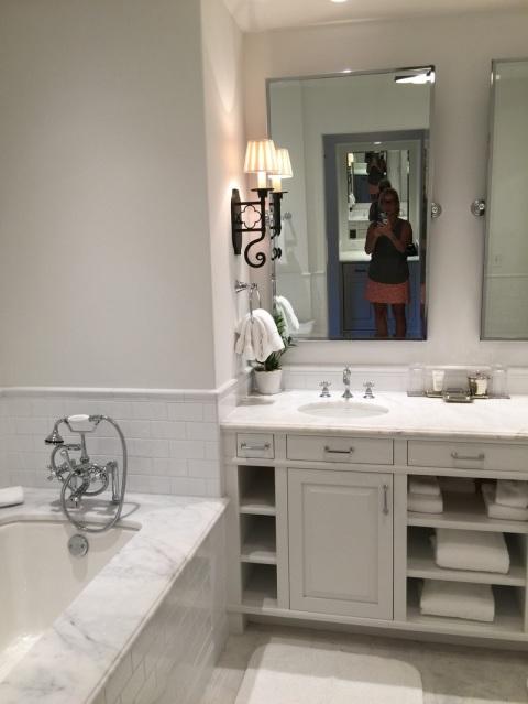 Robin LaMonte in a white bathroom