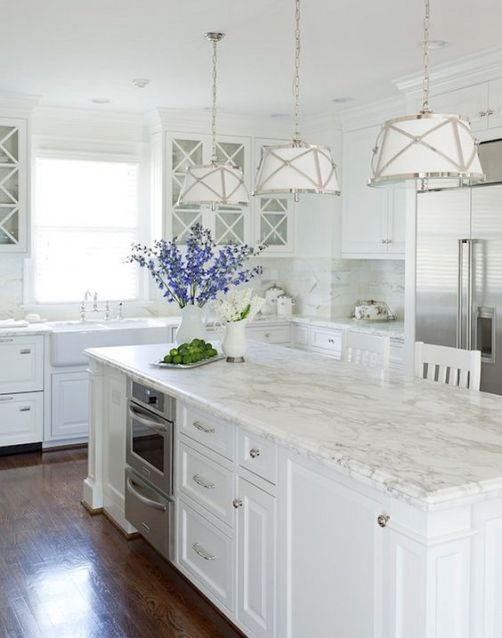 Monochromatic white kitchen with a pop of color