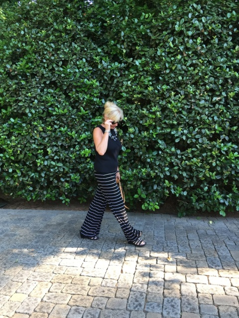 Robin loves her horizontal stripe pants when meeting clients.