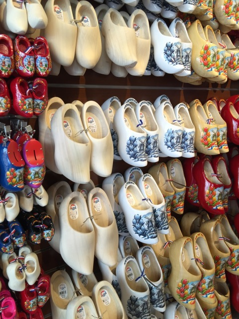The  wooden shoes worn in Holland by the Dutch filled the souvenir shops in Amsterdam.
