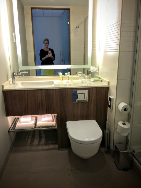Robin LaMonte loves her European bathroom at the Marriott Arena